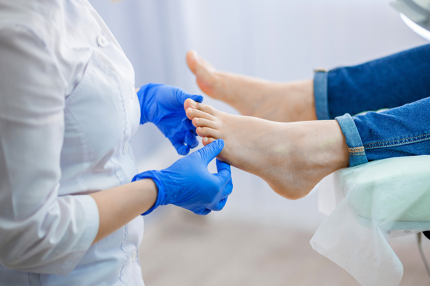 Woman showing her feet to the doctor
